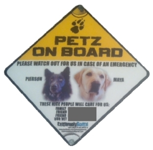 This sign goes on my car window whenever my dogs ride with me in the car. It has their photo and emergency contact information.